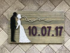 "This board is the perfect gift for a bride and groom!! Please leave the date you wish in the notes to seller! This listing is for a - made to order - string art sign measuring approximately 20 x 11.25"". Boards will be stained dark walnut and strung with colors of choice! The colors"