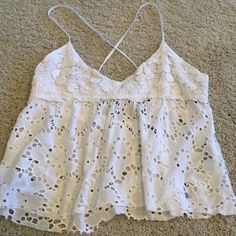 Abercrombie & Fitch Crop Top Abercrombie & Fitch White Eyelet Crop Top -- cross cross straps w/tie in the back.  Large - new with tags Abercrombie & Fitch Tops