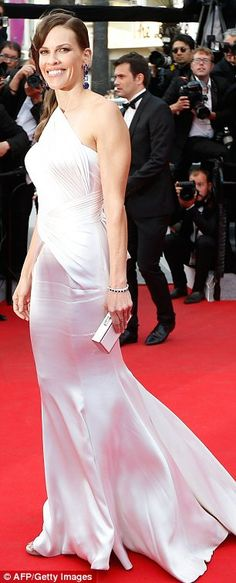 Cannes 2014.  Stunning: Hilary Swank wowed in a bridal style Atelier Versace gown at the Homesman premiere at Cannes on Sunday
