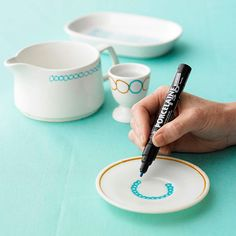 A great DIY idea for putting a personal touch on a thrifted set of dishes.