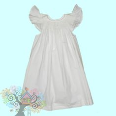 Classic White Angel Wing Sleeve Smocked Bishop Dress with pearl colored beading Visit www.hidenseekboutique.com to order