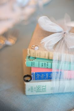 2 or 3 vintage books wrapped with a ribbon add vintage to a table as well.  They look awesome with your arrangements