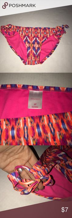 Xhilaration new pink purple print bikini bottom New never worn. Xhilaration size small. Hot Pink purple orange colors. Comes from smoke and pet free home. Xhilaration Swim Bikinis