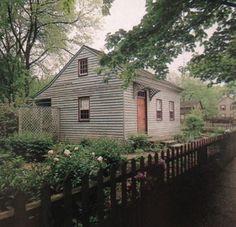 charming cottage with gray clapboard & pumpkin door...