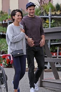 Definitely not risque: Jamie Dornan couldn't have looked more banal as he and his wife Amelia stepped out for a romantic stroll for dinner on Friday evening in Vancouver