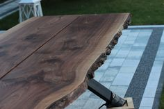 Walnut/steel live edge dinning table made to order by Pracownia Stołów.