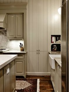 Benjamin Moore Paint Colors:   Cooktop and Island Base Cabinets – BM #1531   Paneled Cabinets – BM Coastal Fog   Wall and Ceiling – BM Early Morning Mist