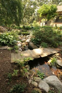 Wooden Plank Bridge with Stream Running Underneath - Aquascape Inc. Garden Stream, Garden Pond, Water Garden, Shade Garden, Garden Paths, Pond Design, Landscape Design, Garden Design, Pond Landscaping