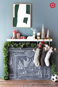 No fireplace? No problem! Hang stockings from a floating shelf stacked above a chalk-drawn fire for that Christmas mantel feel at a fraction of the price of installing a real fireplace. Source: Target via Apartment Therapy Christmas Mantels, Christmas Stockings, Christmas Holidays, Christmas Crafts, Christmas Decorations, Fireplace Decorations, Xmas, Pink Christmas, Christmas Christmas