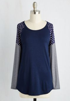 When packing for a weekend getaway, you pick this navy blue top first knowing its fun mix of prints will fit right in with the overall upbeat attitude! The raglan long sleeves of this jersey knit shirt star ivory-dotted shoulders topping fine white stripes, bringing a lighthearted air to everything you do.