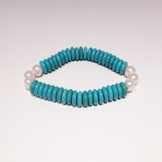 The new #NavyBay natural turquoise and freshwater pearl bracelet #turquoise #beachjewellery #jewellery navybay.co.uk