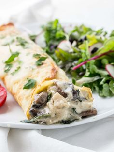 Chicken%20Florentine%20Crepes%20on%20plate%20with%20salad%20and%20tomatoes.