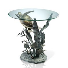 Features:  -Constructed from aluminum and glass.  -Turtle collection .  -Coastal style .  Shape: -Round.  Design: -Table.  Style: -Coastal.  Top Finish: -Metal.  Base Material: -Metal.  Top Material:
