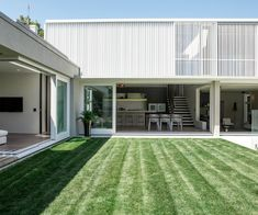 A concrete box on the back of a villa manages to both compare and contrast - Homes To Love
