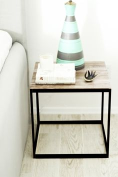 DIY side tables using different con-tact brand paper