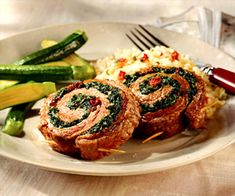 Spirals of lean flank steak encircle a luscious filling of spinach, dried tomatoes, Parmesan, and fresh basil.