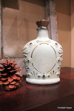 Love the crown royal bottle painted with chalk paint (in Provence)! go to http://www.turnstylevogue.com/2012/02/glass-bottle-makeover.html