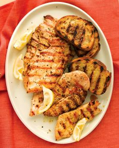 Grilled Lemon Chicken with Garlic Bread - Martha Stewart Recipes #chicken