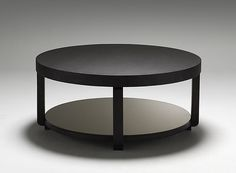 Round coffee table  break up the lines in the room, w/ storage underneath!