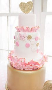 gold and pink ruffle and polka dot birthday cake
