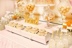 Honey themed dessert table for a bumble bee baby shower.
