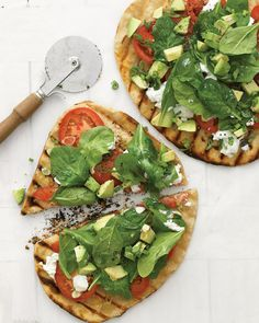 pizza with raw veggies on top.