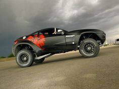 Rally Fighter... It's a car...it's a truck....it's an SUV....Wait? What the hell is it?! BADASS is what it is!
