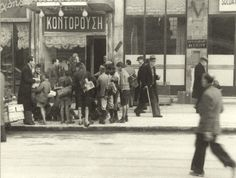 "Athens, Greece, winter of 1941-1942. Kids surround German officers asking for food outside ""Averof"" restaurant on Stadiou str."