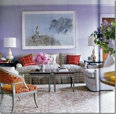 I love the cool lavender walls and the other pops of color in the room accents.  A well-appointed room.