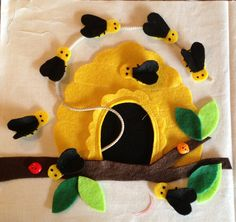 Another page for our quiet book.. So much fun sewing with felt. Bees and hive.