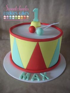 Toy Drum Cake  A replica of Max's favourite toy as he turned 1 year old. Even the 'drum sticks' are edible!    By Sweetcheeks Cookies and Cakes