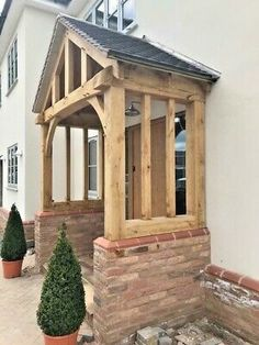 When designing a brand new porch, contact an architect and licensed contractor to make sure that it's designed appropriately. Cottage Front Doors, House Front Porch, Cottage Porch, Front Porch Design, Bungalow Exterior, Cottage Exterior, English Cottage Interiors, Porch Canopy, Timber Door