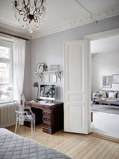 Bedroom with a study corner of vintage and modern furniture