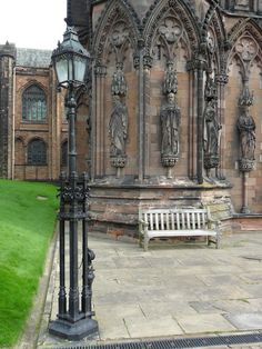 Ornate Victorian lamp post and statues at Lichfield Cathedral, Lichfield, Staffordshire, England