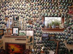 """The Paua Shell House holds the largest display of paua shells in New Zealand, lining the walls of their """"Paua Lounge."""""""