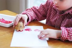A heart-shaped potato stamp is a great Valentine's day craft for toddlers and preschoolers.