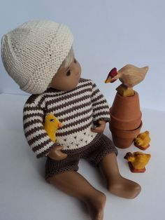 Sweater set in stripes with Felt Chick. Hand-knitted outfit for Baby Sasha Doll