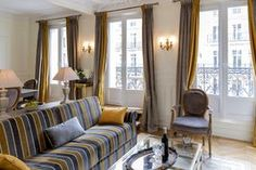 #Paris #rentalapartment #sofa #curtains #haussmann #moldings #hardwoodfloor #sconces #antiques