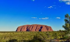 Uluru is a big red monolith in the middle of the desert. It changes colour according to the sunlight, offering spectacular sunsets and awesome sunrises. Color Change, Adventure Travel, Monument Valley, Island, Sunrises, Sunlight, Middle, Colour, Big