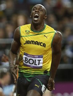 Power and Determination. Bolt celebrates his 100m win