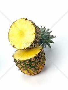 Pinapple cut in half - A pineapple on white that has been cut in half showing the centre of each piece.
