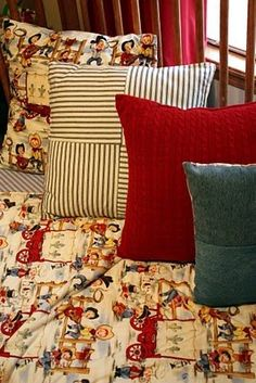 Love the Vintage Material they used for the Quilt and matching Pillow