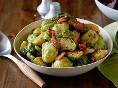Brussels Sprouts with Bacon : Salty, crispy bacon makes everything better, especially these Brussels sprouts served warm as a holiday side dish.