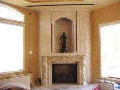 Luxury decorated limestone corner fireplace