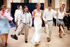 """Wedding guests getting their groove on. """"Now kick, now kick, now walk it by yourself."""""""