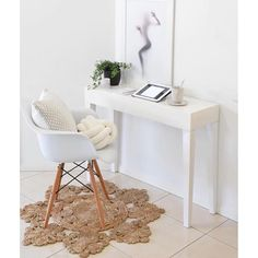 Simple little office space | love the rug, chair & cushions Photo taken by @lovelypair