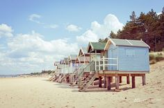 Is there anything more British than a  beautiful summer beach hut? #pleats #please #feelunique