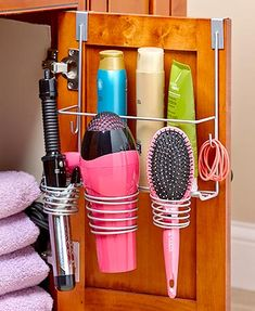 Organize your hair styling tools and products in one convenient spot with this Hair Care Organizer. The 3 spiral holders are perfect for storing appliances such