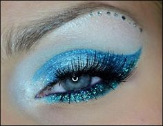 Sparkly light blue cat-eye makeup with a crystal accented brow.