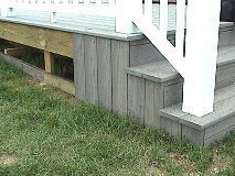 Deck skirting made from scraps of synthetic decking.